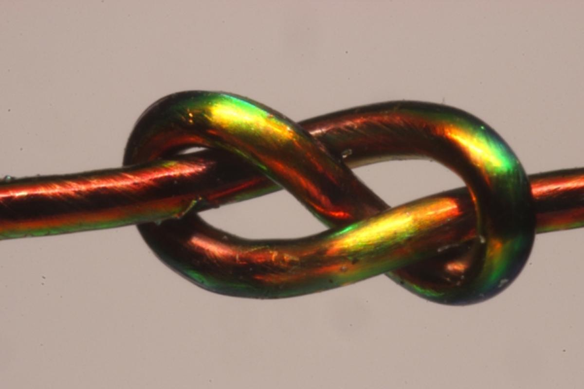With the help of color-changing fibers, MIT researchers develop a mathematical model to predict a knot's stability