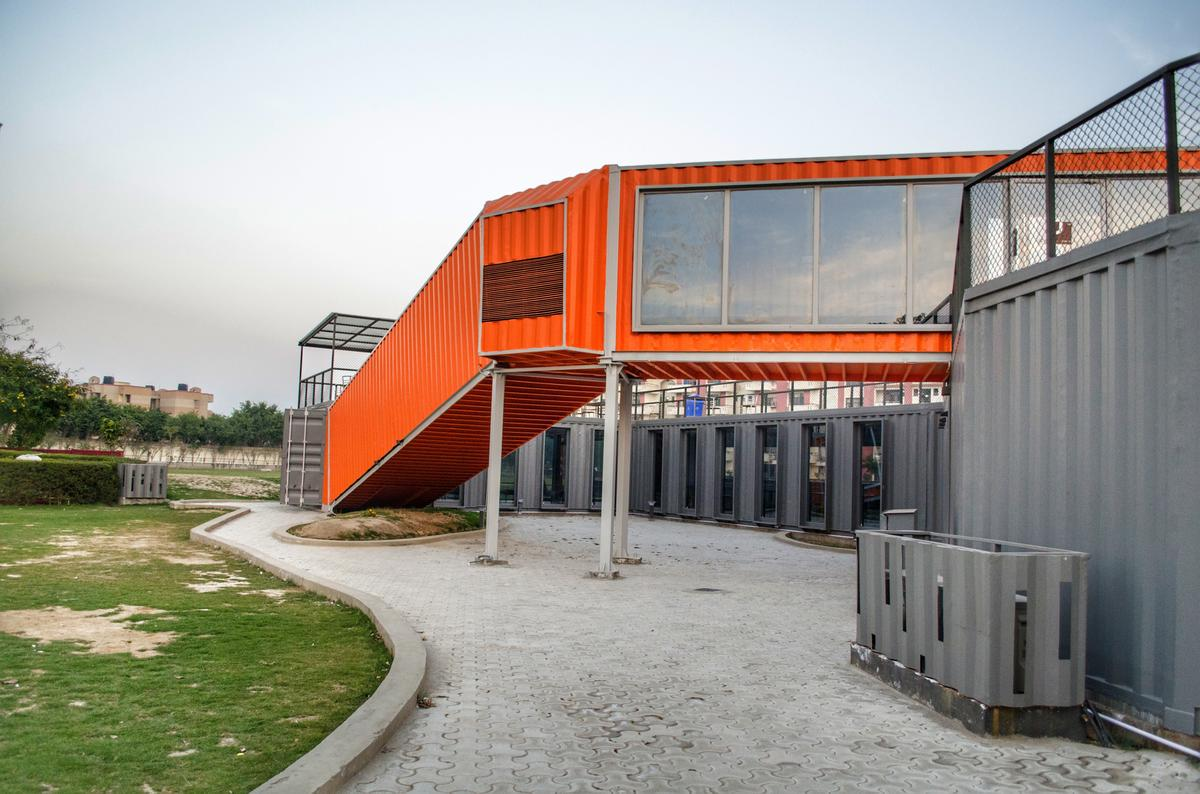Café Infinity's containers are painted orange and gray