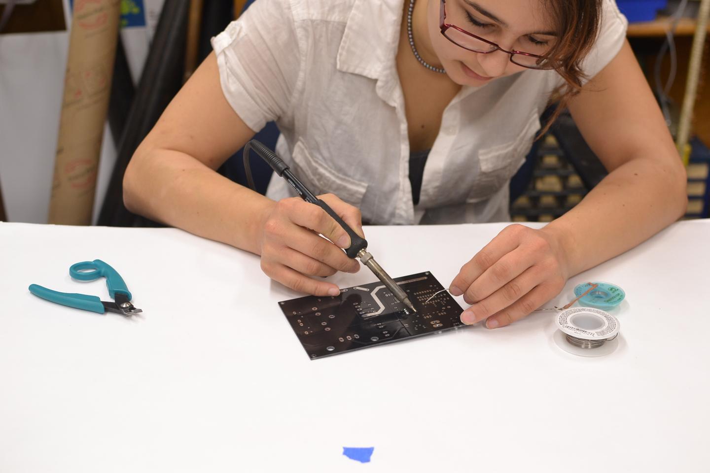 The oneTesla team's Heidi Baumgartner showing off her soldering skills