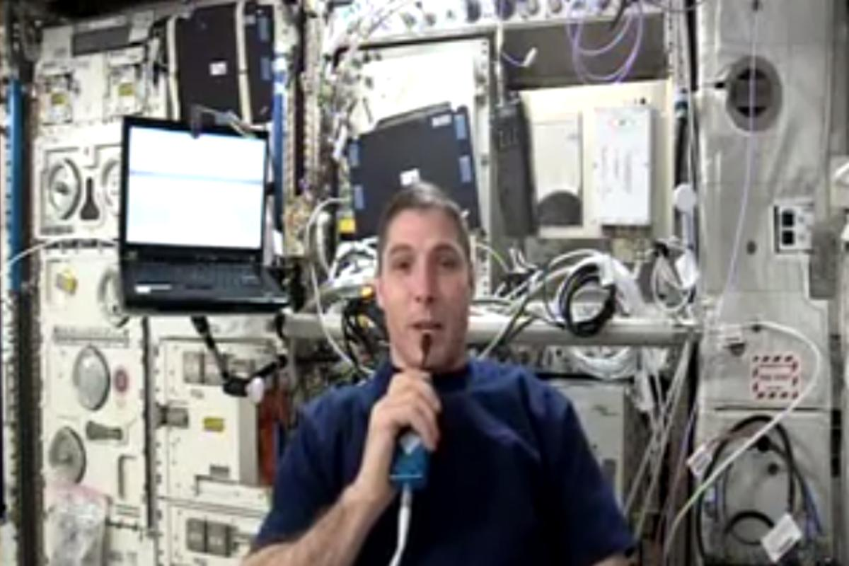NASA astronaut Mike Hopkins making the first ham video transmission