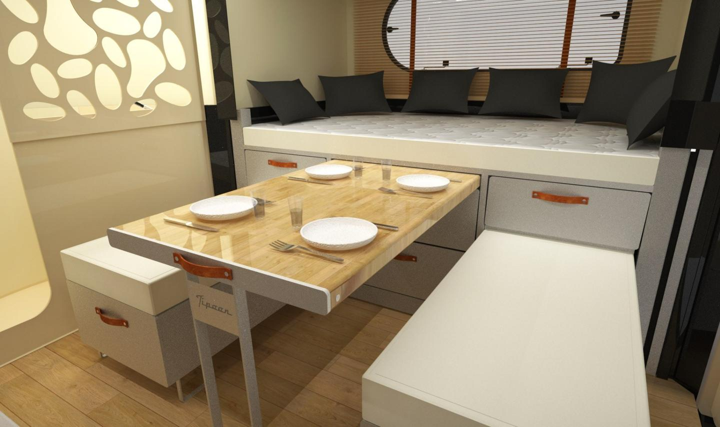 One of four dining/bedconfigurations, the Tipoon dining area features a slide-out table and dual benches