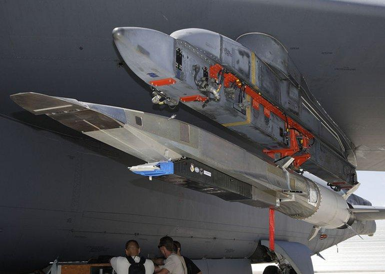 The X-51A WaveRider hypersonic flight test vehicle mounted on an Air Force Flight Test Center B-52