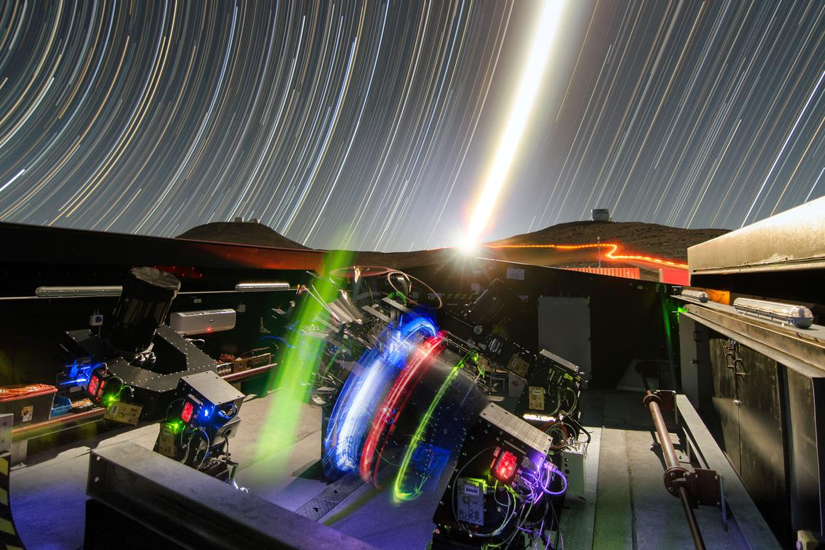 A long-exposure night time view of the NGTS telescopes during testing – the ESO's VISTA is visible on the right and the VLT on the left, in the background of the image (Photo: ESO/G. Lambert)
