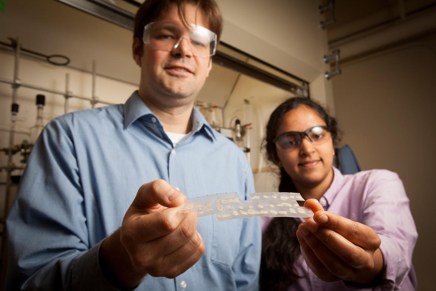 Prof. William Dichtel and Deepti Gopalakrishnan with samples of the polymer