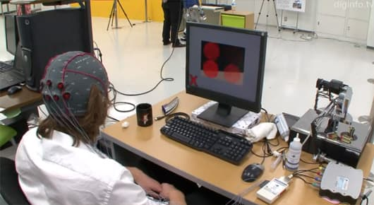 The robot's field of view can be directed by concentrating on one of the blinking circles overlaid on its camera image