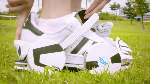 Each Walk Wing attaches to the user's existing footwear via a heel strap, toe cover, and a ratcheting ankle strap