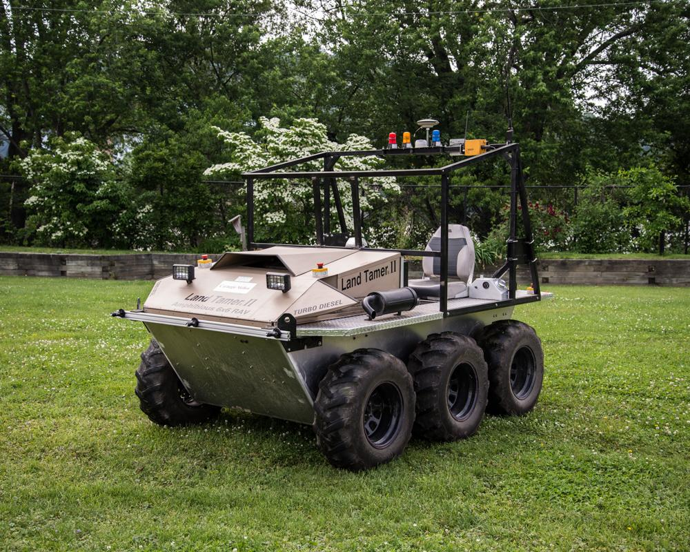 The autonomous Land Tamer vehicle, which will be dropped off to explore a rugged area by a likewise-autonomous Black Hawk helicopter