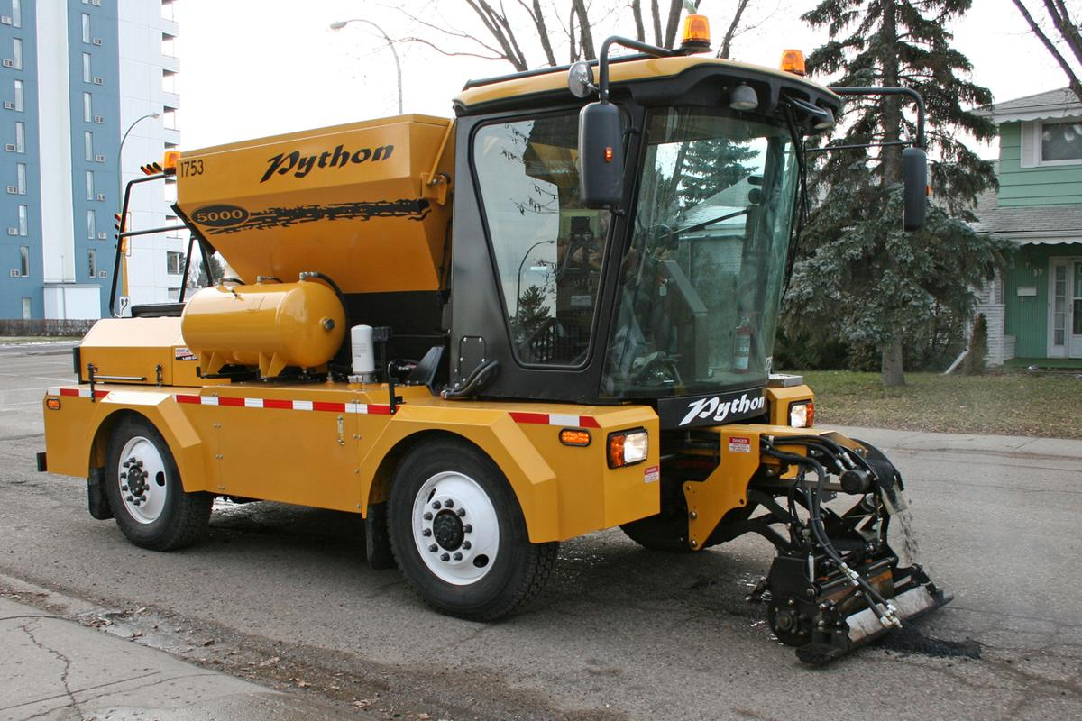 The Python 5000's single operator can quickly fill potholes from within the vehicle's cab