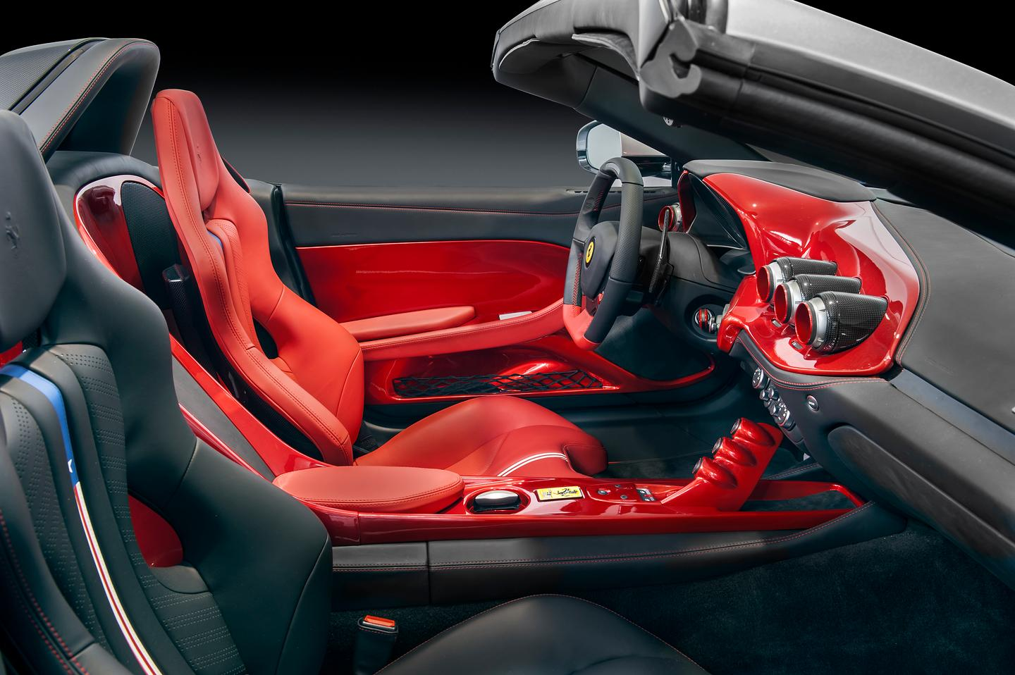The F60's interior is trimmed in red on the driver's side, and black on the passenger side