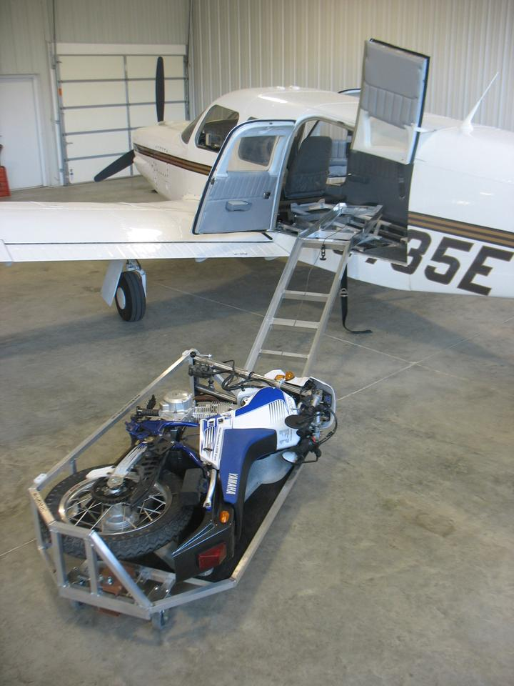 The MotoLOAD consists of a sled into which a MotoCYCLE is laid and winched into the airplane