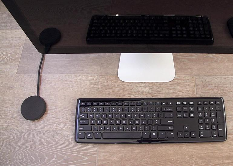 The Paperspace computer is a small puck-shaped device called the Paperweight