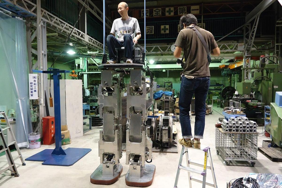 Hajime Sakamoto sits in the pilot seat of his 4 meter tall robot