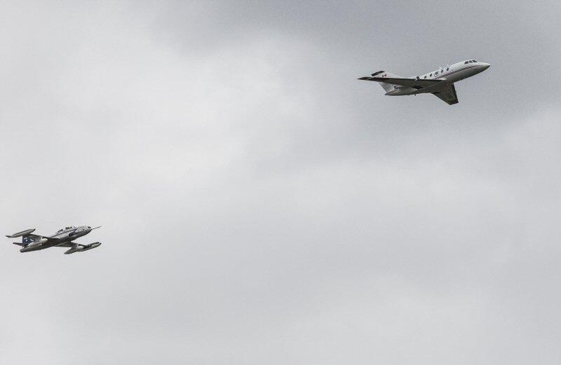 The 100 percent biofuel-powered Falcon 20 being tailed by the data-collecting T-33