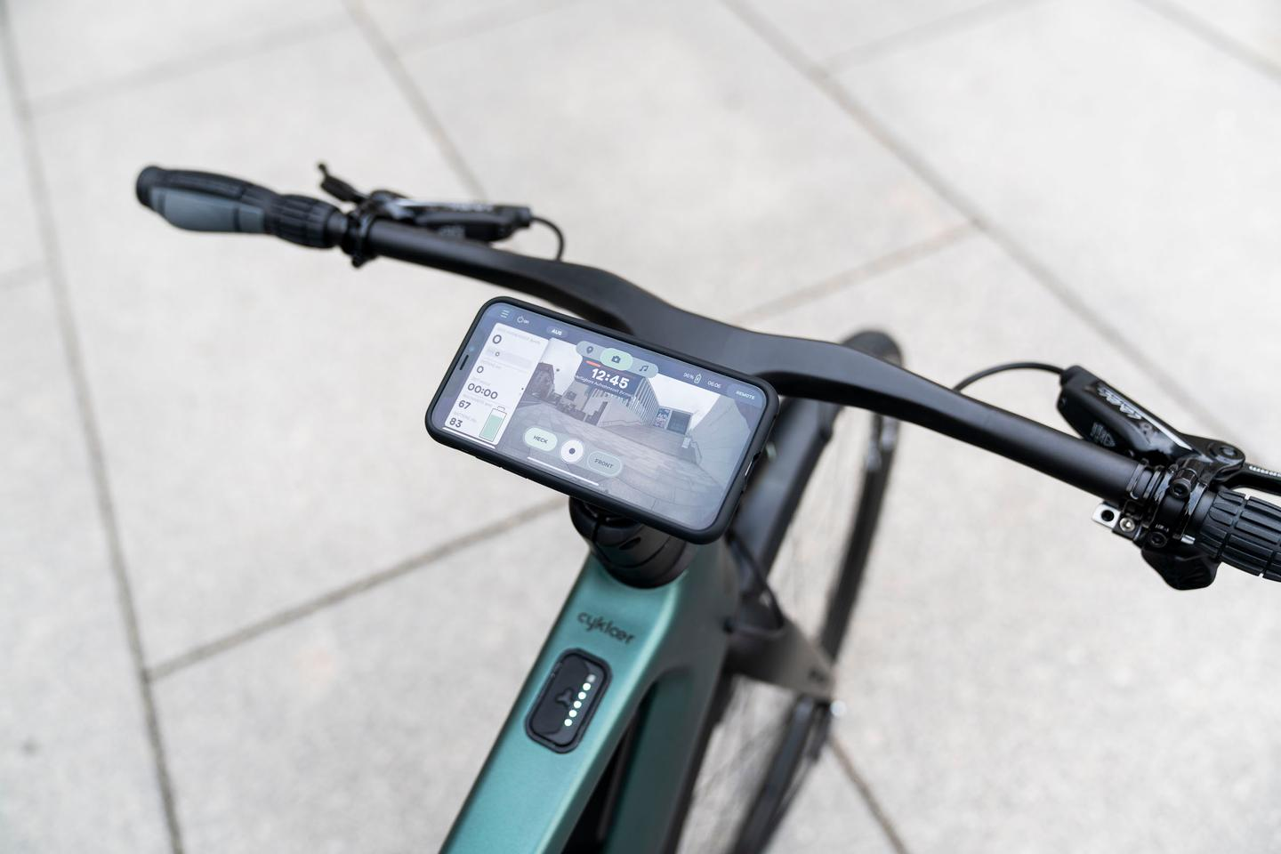 Utilizing a dedicated Porsche Digital-designed app, riders can view the rear camera's live video on their handlebar-mounted smartphone