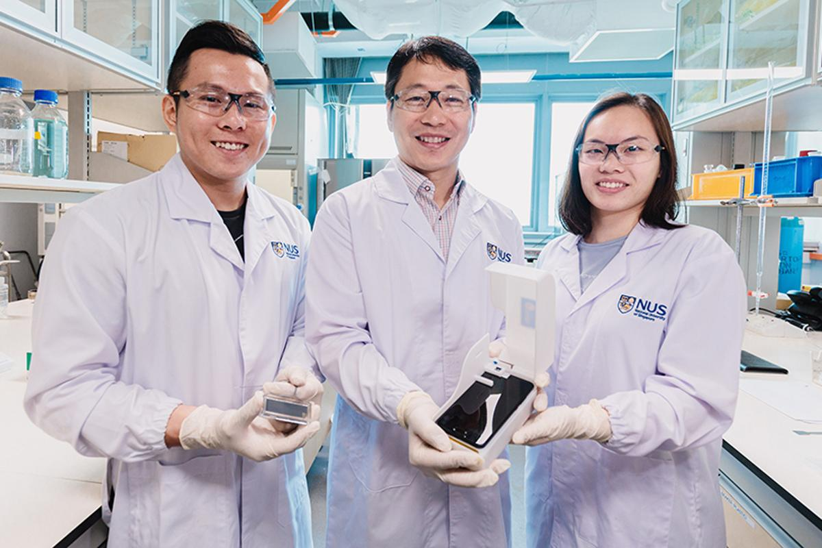 The research team, from left to right – Thio Si Kuan (with the chip), Bae Sung Woo (with the phone platform) and Chiang Li Ching Elaine