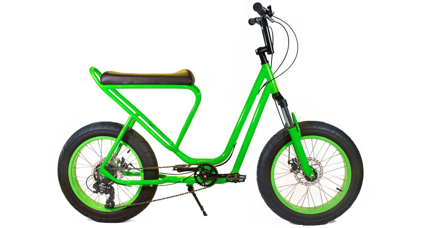 The Monkey Faction Capuchin's scooter-like features include a long padded seat, a 7000 series aluminum step-through frame, and a fully-upright feet-forward riding position