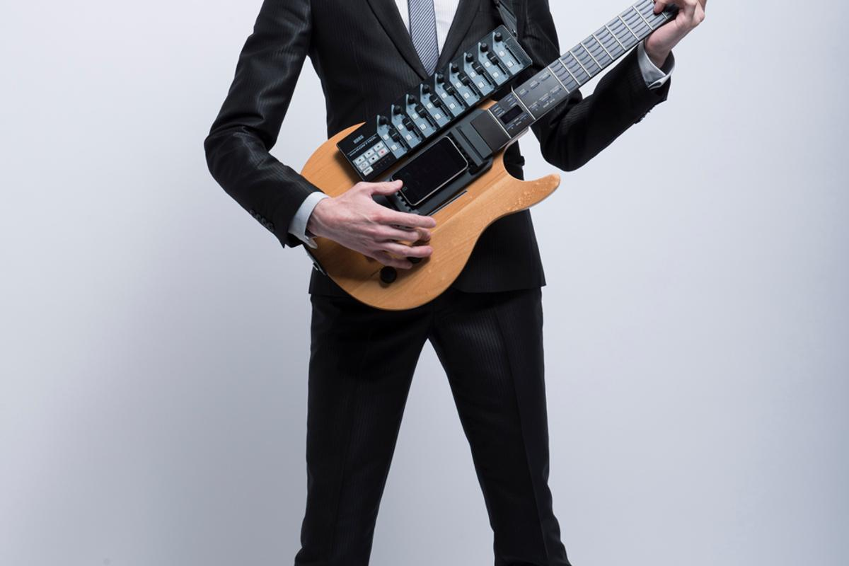 Uni Sun, who performs as Omni Infinity, has launched a guitar-shaped digital controller/instrument called the SPACEBASS:01