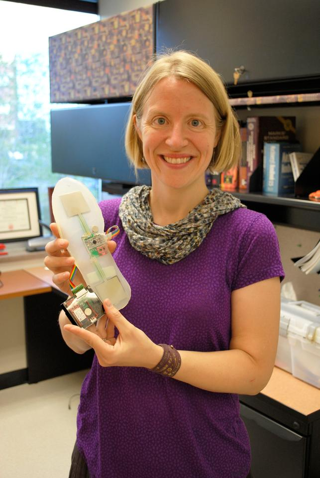 Prof. Stacy Bamberg with a Rapid Rehab prototype
