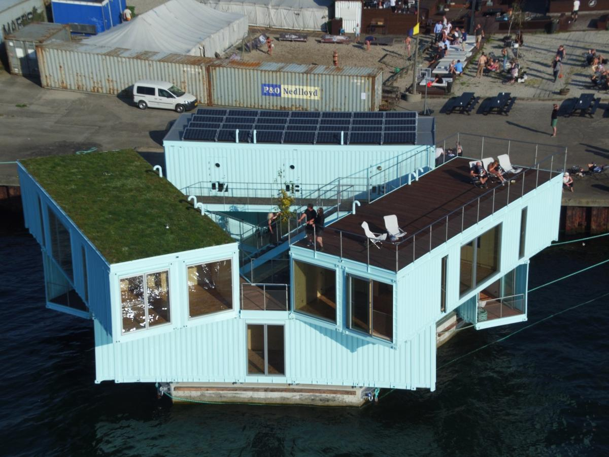 Urban Rigger comprises nine recycled shipping containers arranged on a floating base