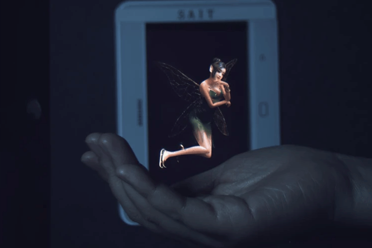 Thanks to Samsung's prototype hologram device, the fairy appears to be hovering in the hand – but in actuality she's displayed on the screen in the background