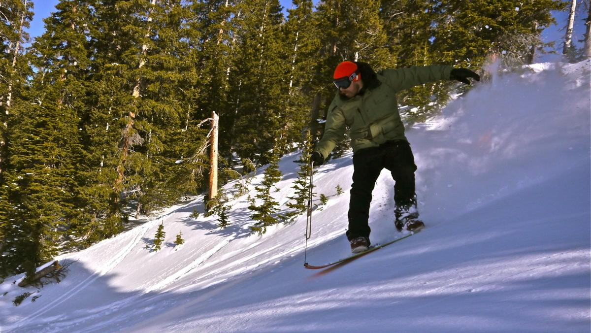 """The Signal crew surfs powder in roped """"Snurfer"""" fashion Photo: Erin Paul Hines"""