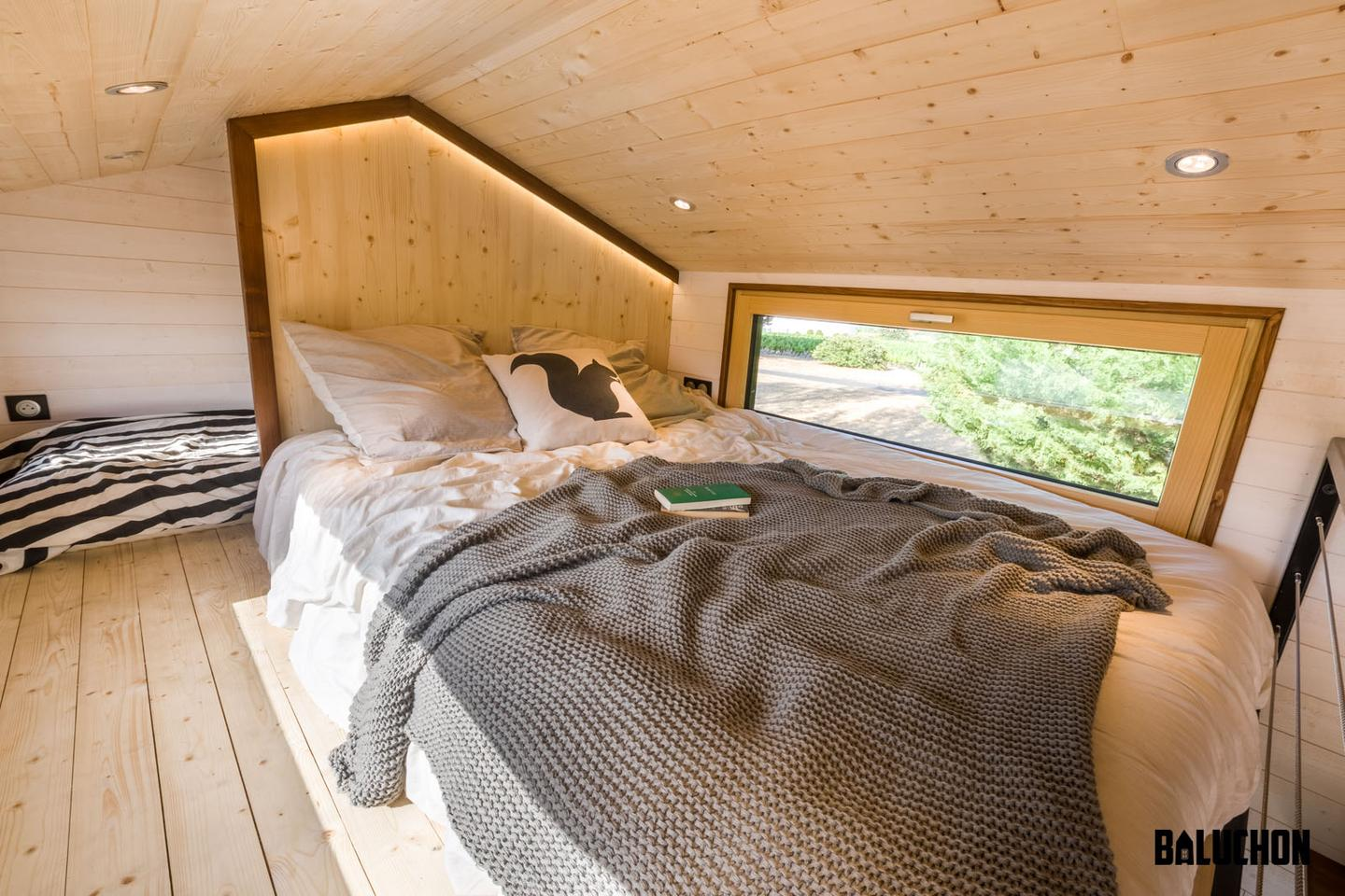 The Hauméa tiny house's two bedrooms are squeezed into one loft space