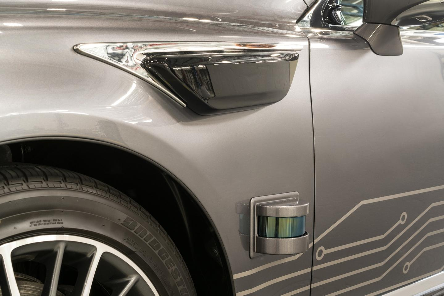 The long-range LIDAR sensors are augmented by shorter-range sensors positioned low on all sides of the Lexus testvehicle