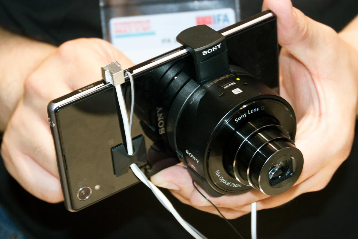 The QX100 is one of two new add-on cameras that can be mounted on mobile devices, such as the new Xperia Z1