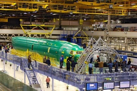 The first P-8A fuselage is lowered into a tooling fixture in Renton, Wash.Photo: Boeing image - Jim Anderson