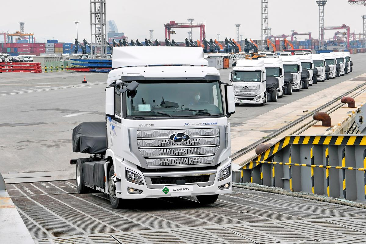 The first 10 hydrogen powered Xcient Fuel Cell trucks board a ship in Korea headed for Switzerland