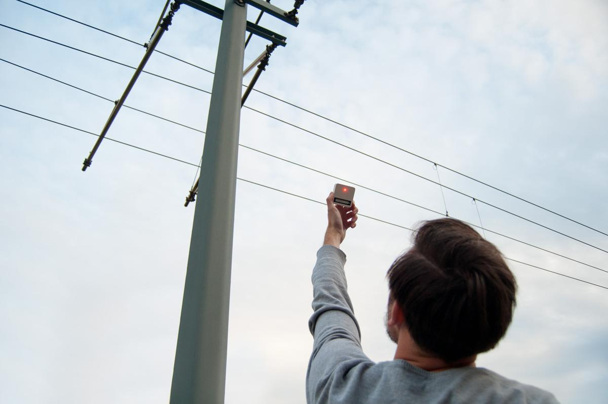 The handheld Electromagnetic Harvester allegedly charges a AA battery using just the electromagnetic fields given off by gadgets, power lines, vehicles, and even living things