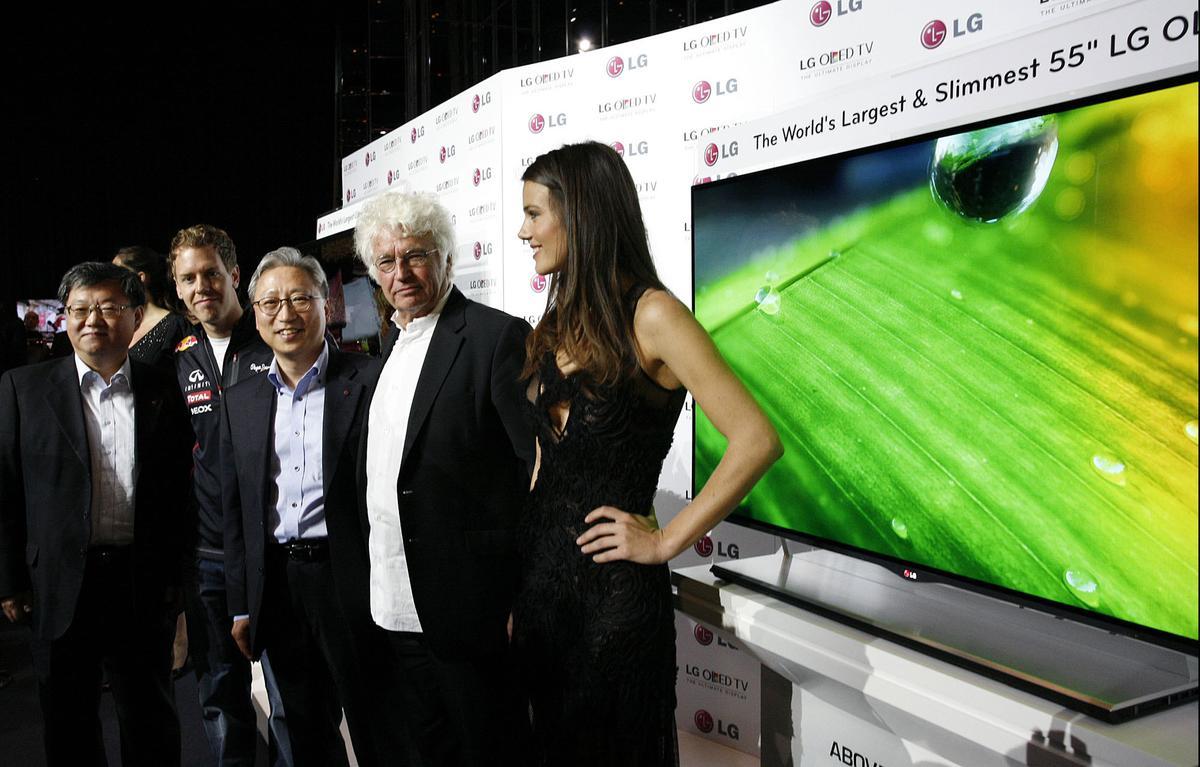 LG VP of Overseas TV Sales and Marketing Ki-il Kwon, F1 Champion Sebastian Vettel, LG Europe's Stanley Cho, film director Jean-Jacques Annaud and model Gemma Sanderson at the Monaco unveiling