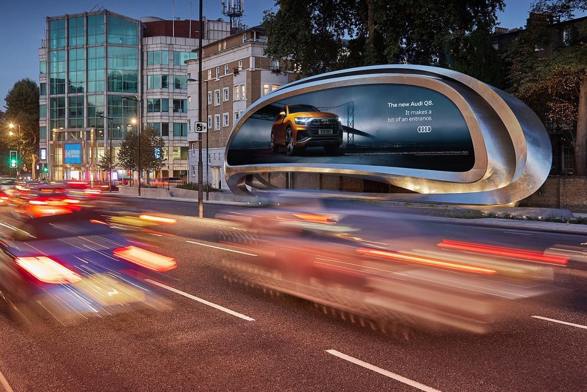 To the front, the Kensington billboard displays adverts to London drivers, while pedestrians at the rear get to enjoyZaha Hadid's signature design language