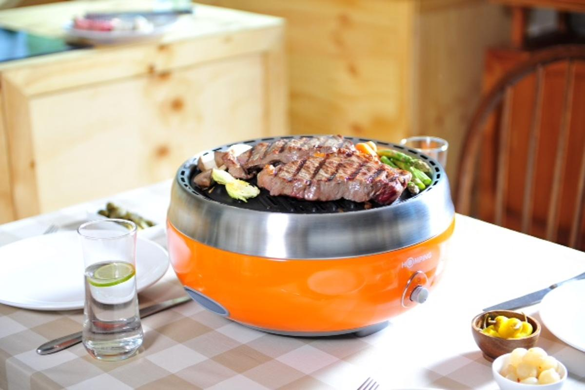 The Homping Grill uses a fan-assisted charcoal design for a combination of flavor and convenience