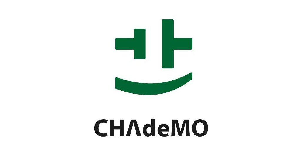 The CHAdeMO logo is made up of the circuit symbol for a battery and a curving line representing movement, which also just happens to look like a smile