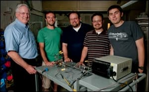 Prof. Brain Cantwell (left) with graduate students and a nitrous oxide decomposition cell