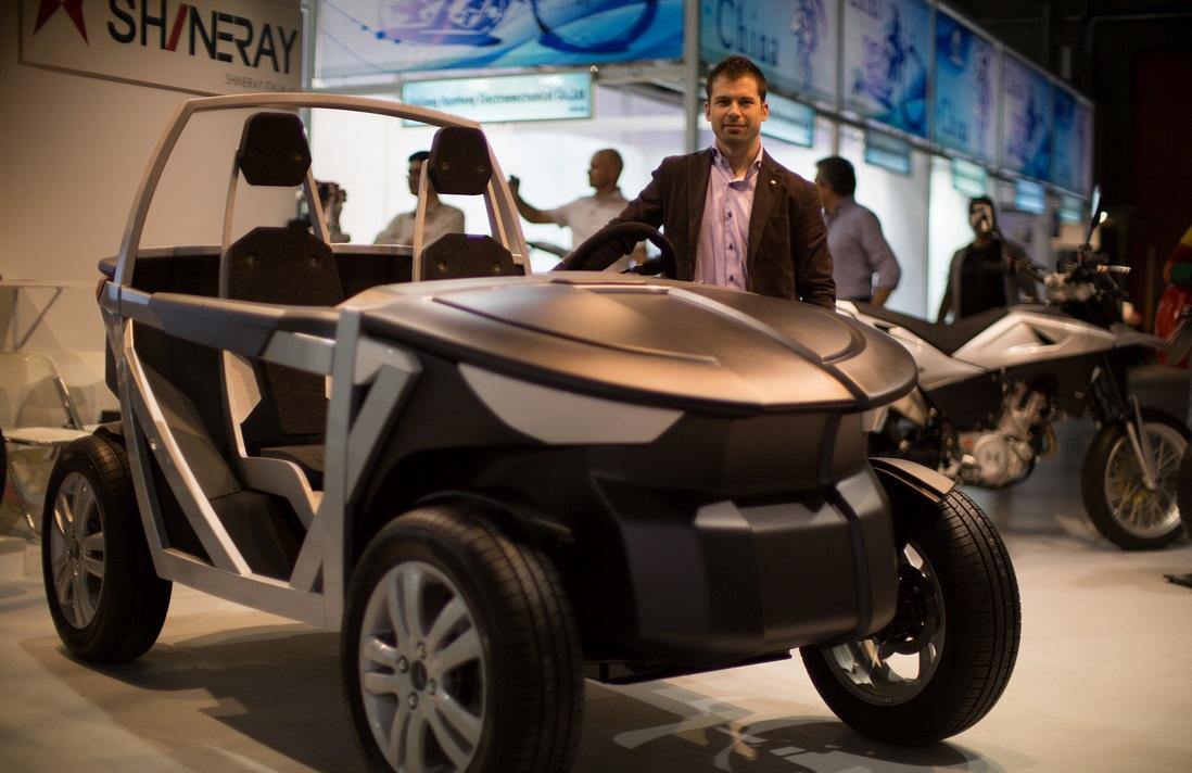 OSVehicle Project Chief Designer Marco Borge stands next to the Urban TABBY during EICMA Milan 2013