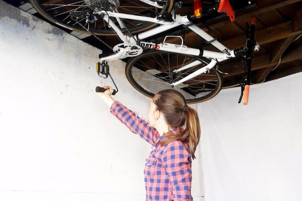 The Hide-A-Ride rack stores bikes parallel to the ceiling