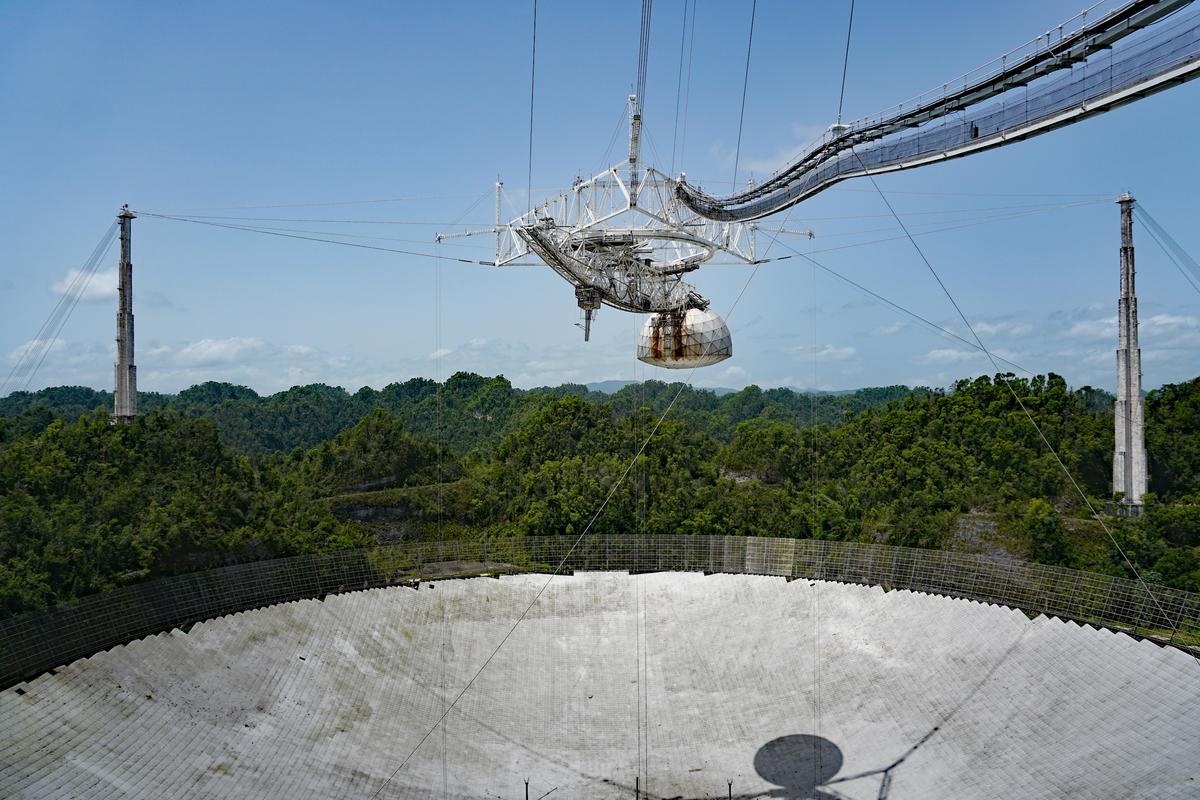 The Arecibo radio telescope, pictured here still intact