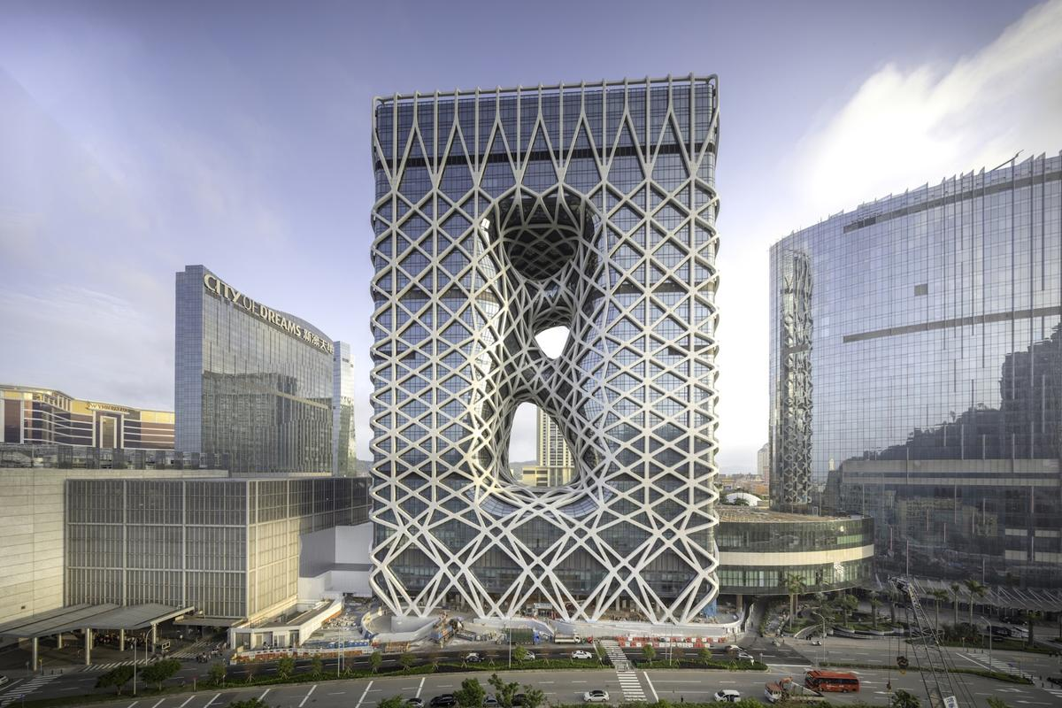 Morpheus Hotel is wrapped in a steel and aluminum exoskeleton that provides structural support