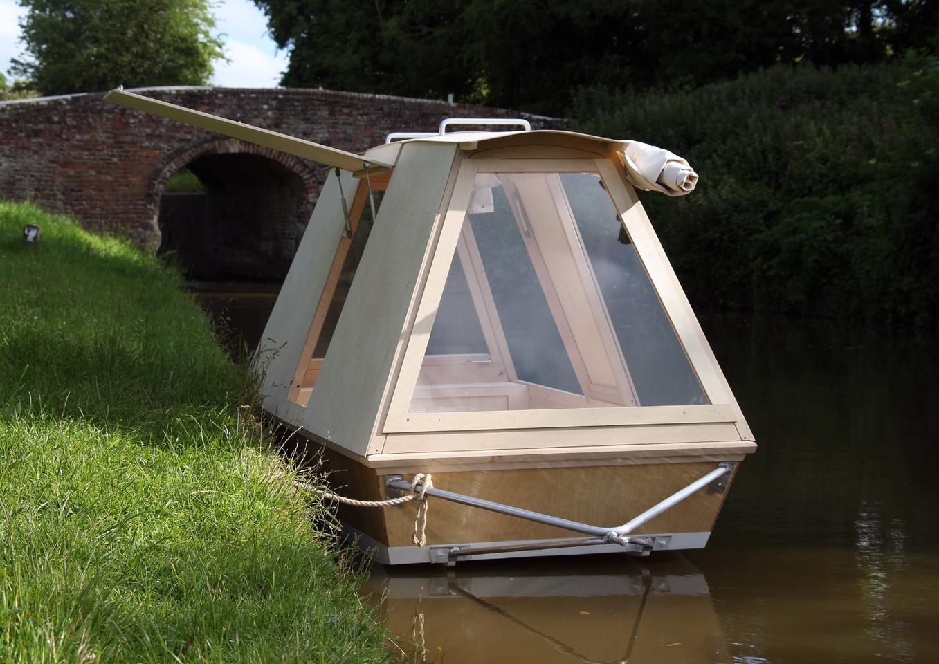 Nomadic floating shelter gets towed to the water by bike