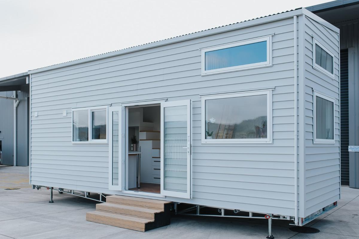 The Dance Tiny House was delivered as a turnkey build excluding appliances and cost around NZD 114,000 (roughly US$75,000)