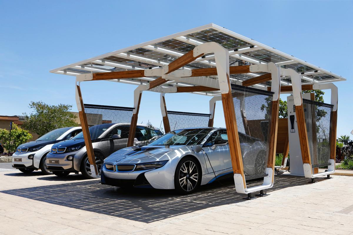 Designed by Designworks USA, the solar carport was developed to not only be aesthetically interesting but to also compliment the new i8 and i3's designs traits
