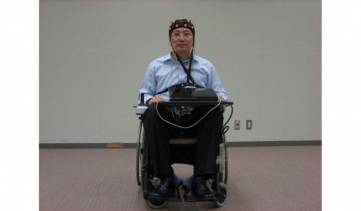 The Toyota/RIKEN wheelchair - this laboratory prototype runs with the EEG detector run by a laptop (Photo: RIKEN)