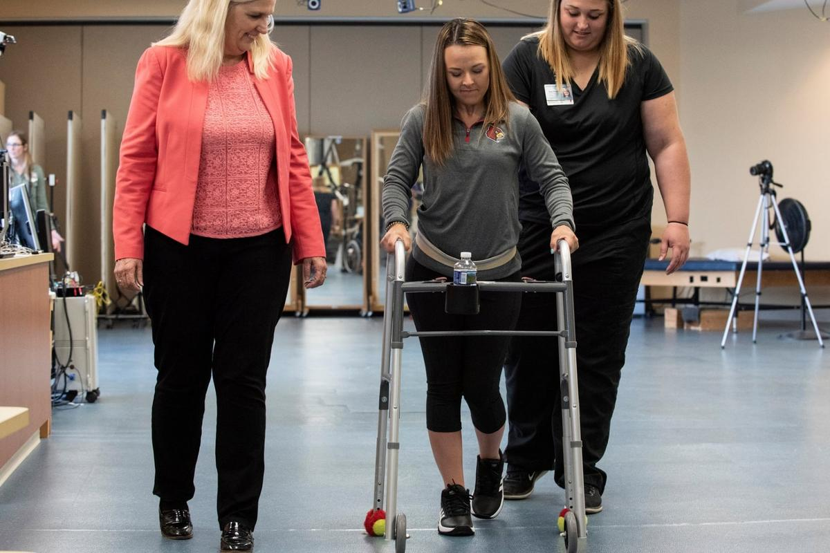 Kelly Thomas (center) walks independently after success with the new groundbreaking treatment