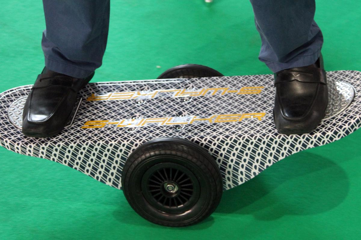 The S-Walker Board combines aspects of a Segway, a balance board and a skateboard