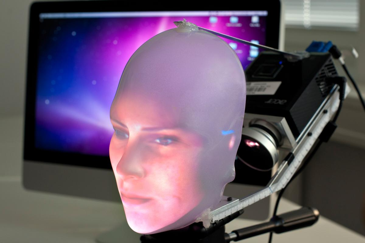 Mask-bot uses a small projector to beam the image of a face onto a transparent plastic mask