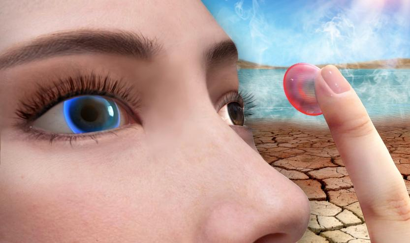 Ordinarily red, the lens turns blue when placed on an overly-dry eye
