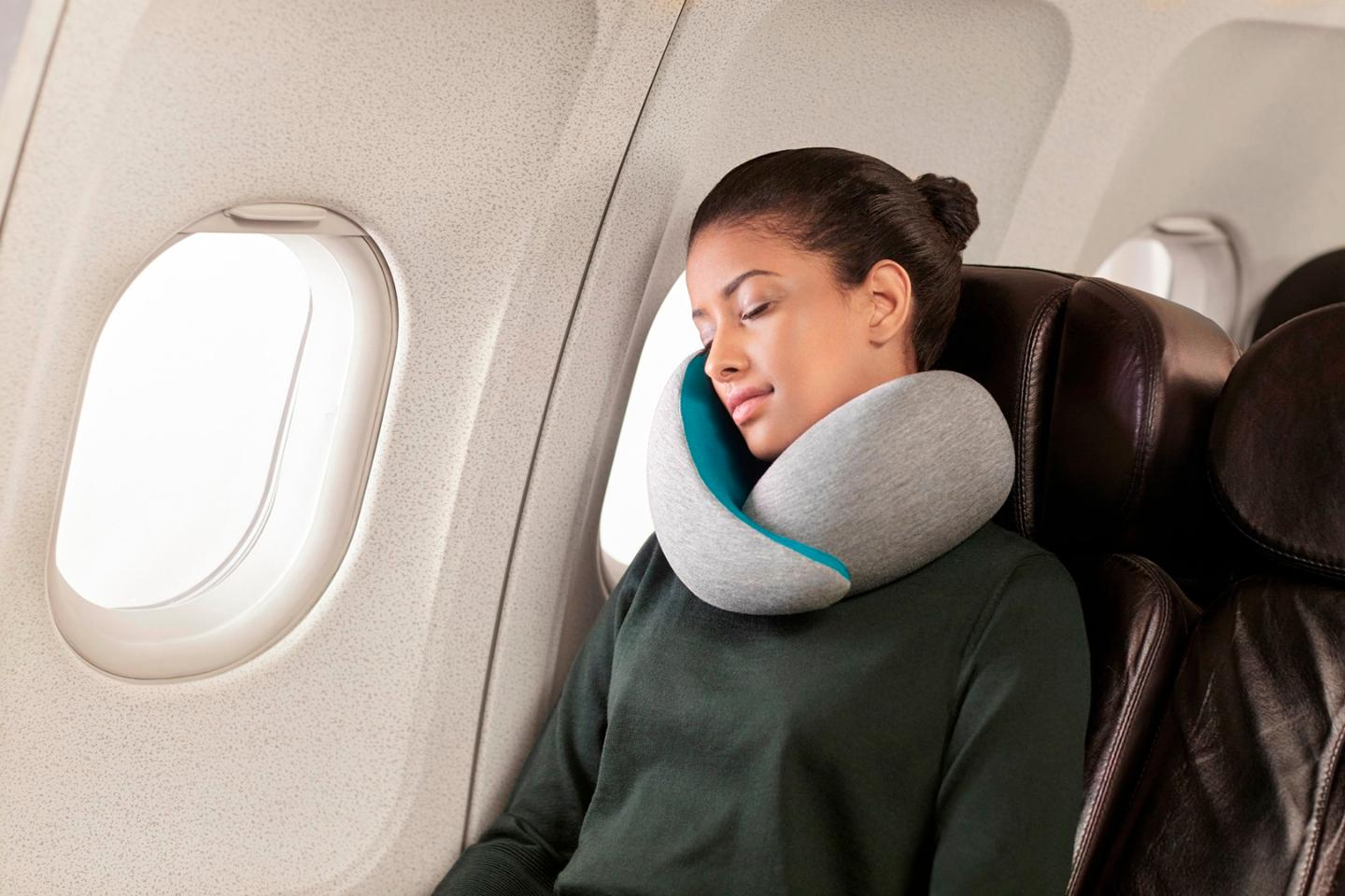 The Ostrich Pillow Go is a travel pillow that is fitted around the user's neck
