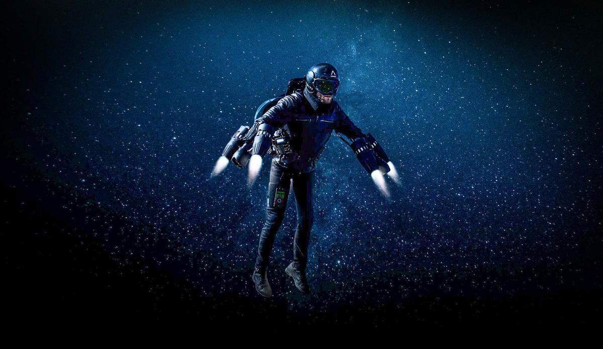 Richard Browning flies the Gravity Jet Suit against a starry sky in this clearly photoshopped image